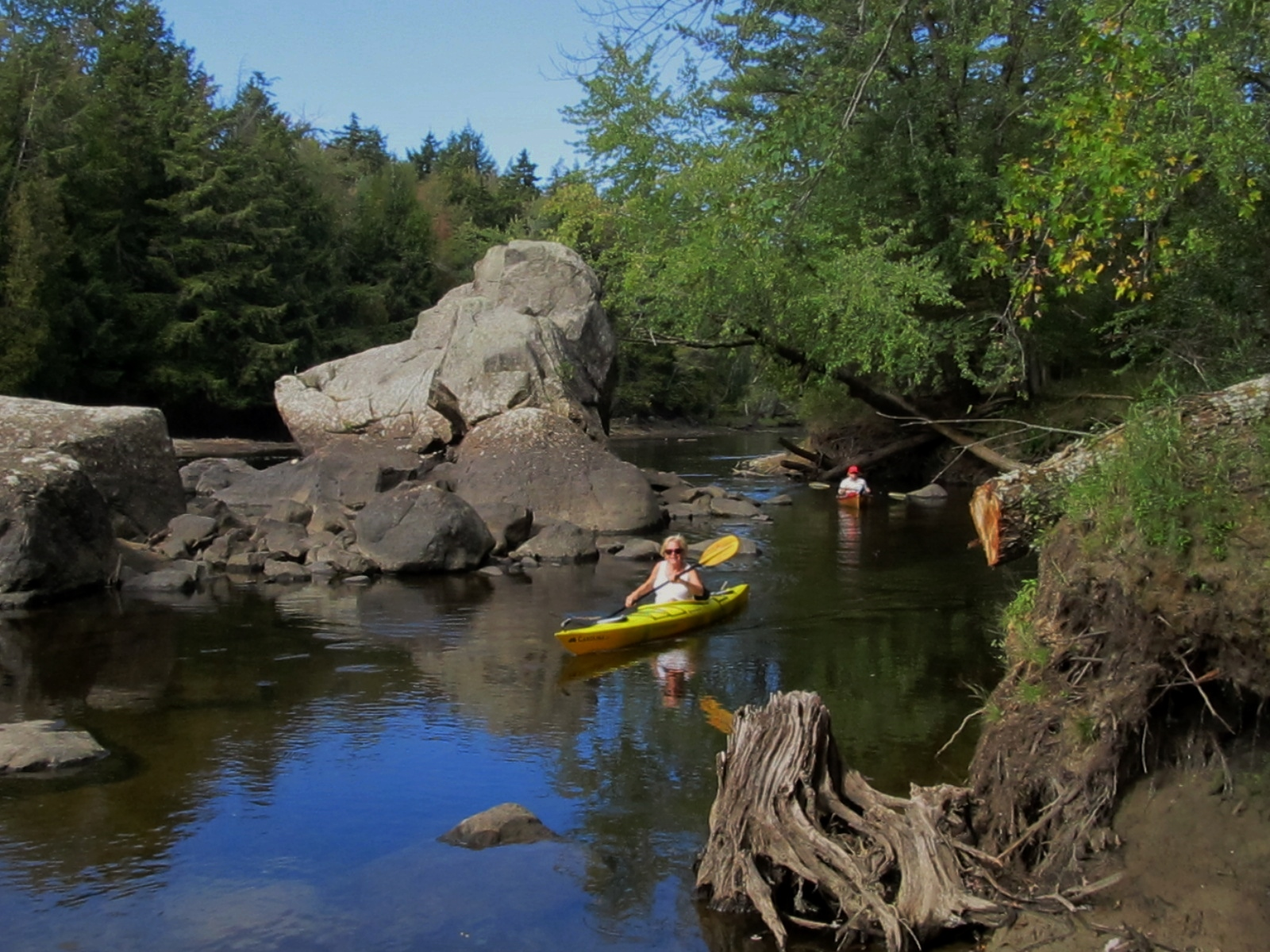 Jane and Anne paddling near the boulders at our destination - Raquette River Falls!