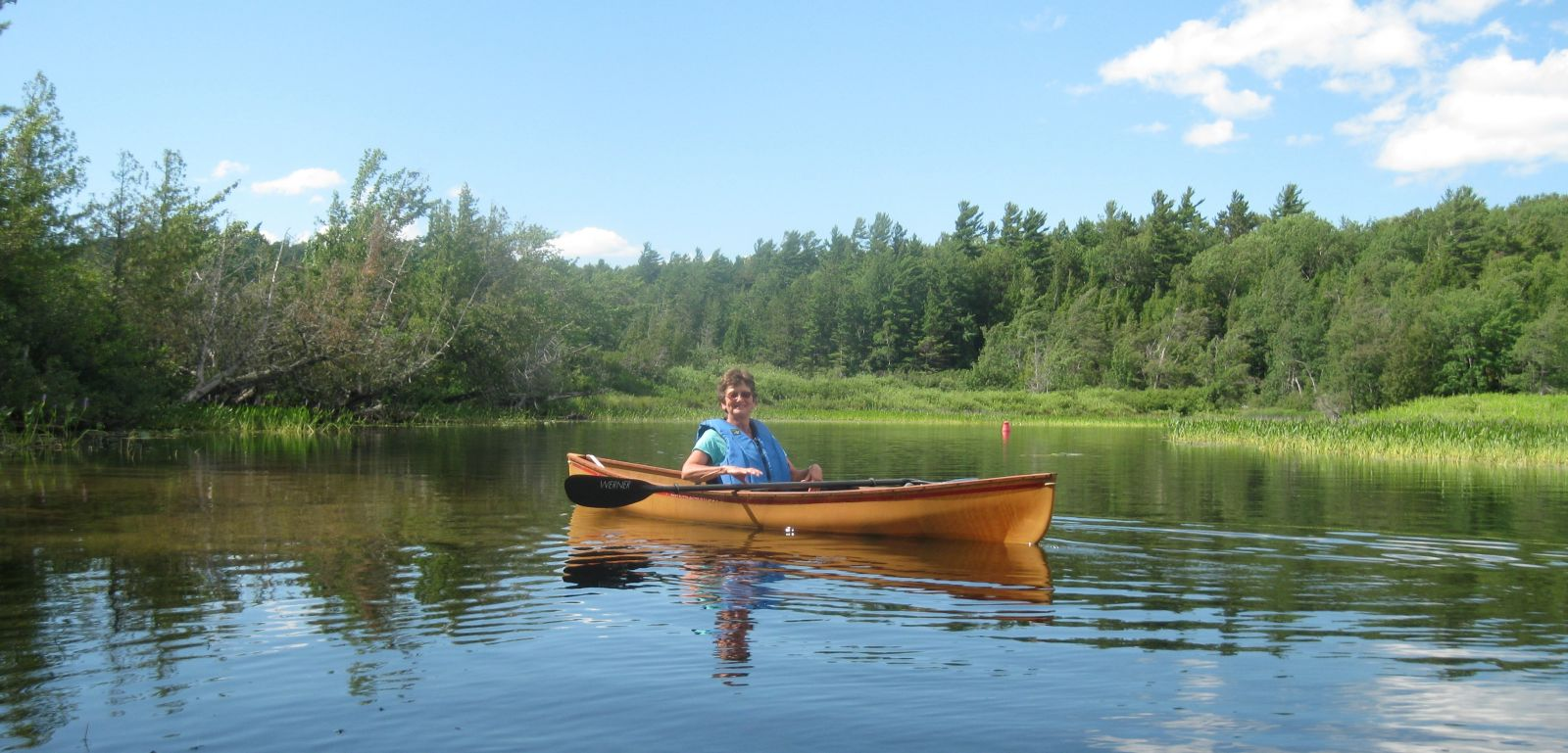 Elaine on the Saranac River, heading back to South Creek.