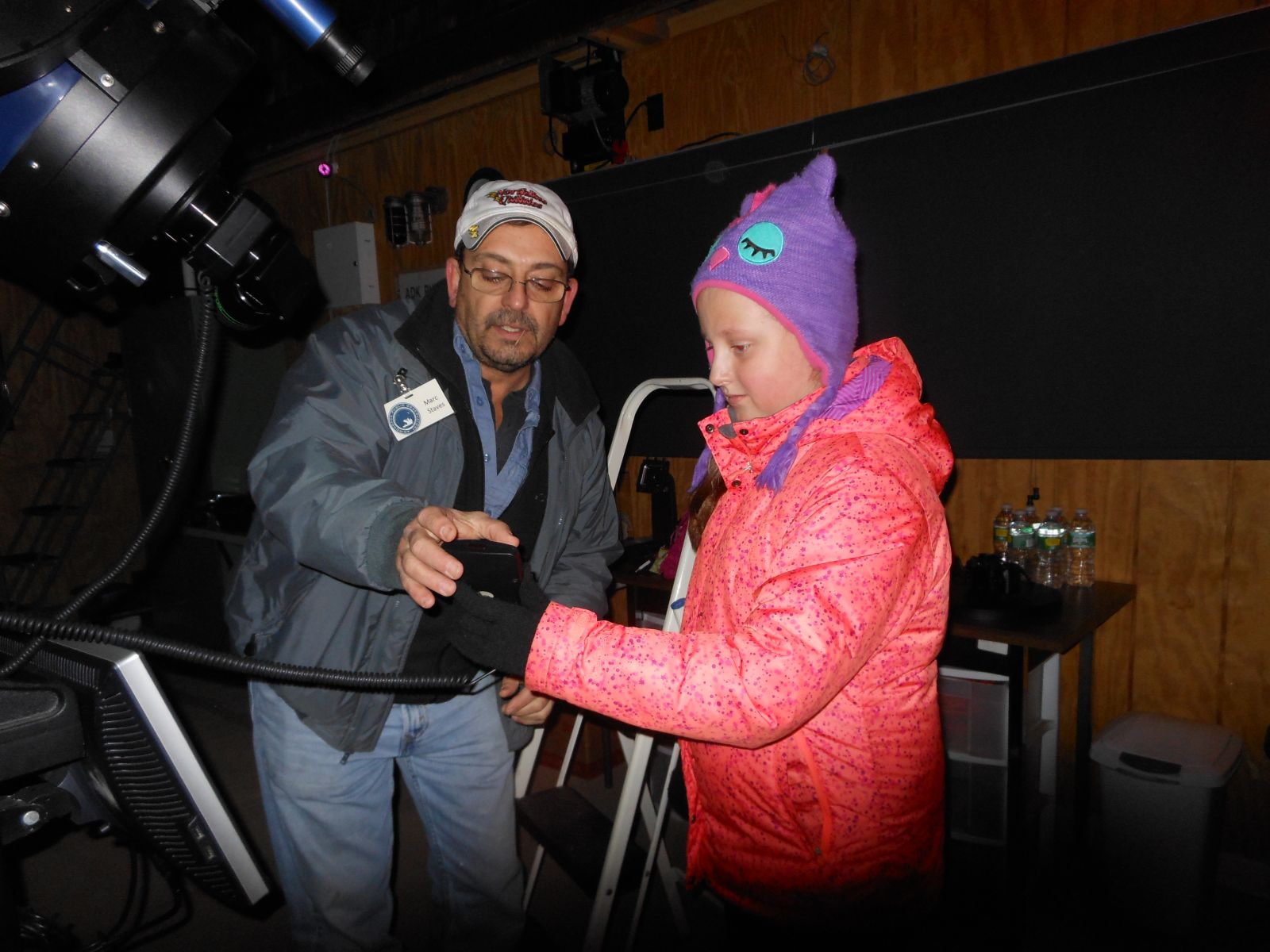 Marc showing Genna how to use the telescope