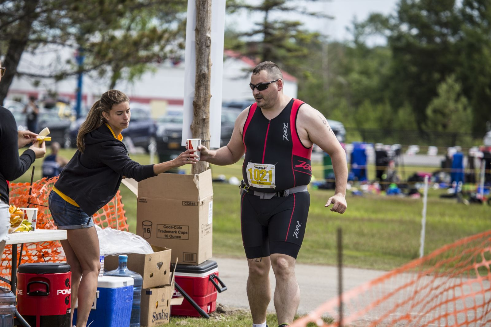 Volunteers provide support to Tinman athletes before, during, and after the race.